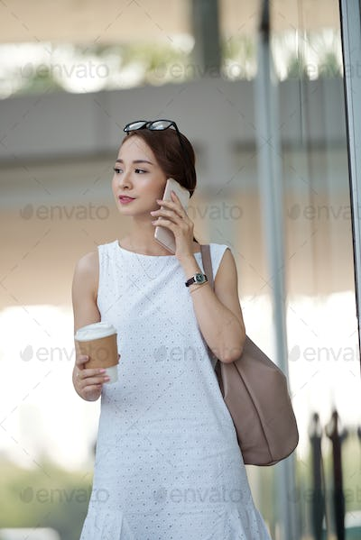 Pretty woman with smartphone and coffee