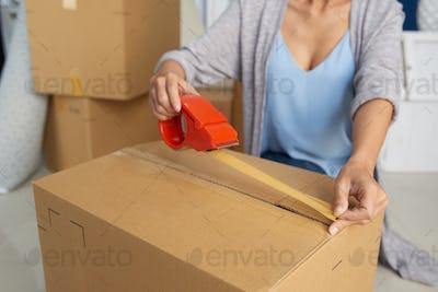 Woman Packing Carton Box