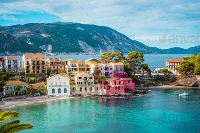 Assos village. Beautiful view to vivid colorful houses near blue turquoise colored transparent bay