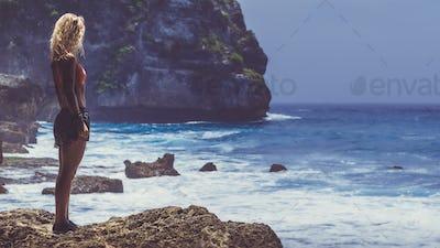 Girl on Tembeling Coastline at Nusa Penida island, Bali Indonesia