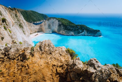 Rock Cliffs in front of Navagio beach Zakynthos. Shipwreck bay with turquoise water and white sand