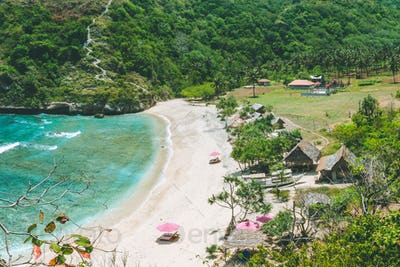 Beautiful idyllic white sand Atuh beach appealing for relax. Clear blue ocean waves rolling to the