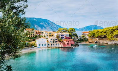 Panoramic view of Assos village in Kefalonia, Greece. Turquoise blue colored water in Mediterranean