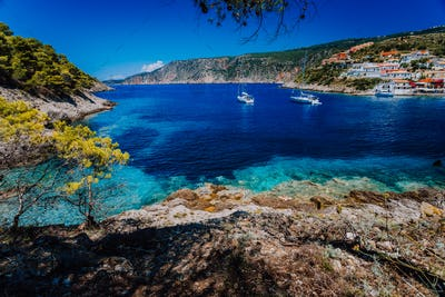 Amazing Greece, white sail boats in blue bay of picturesque colorful village Assos in Kefalonia