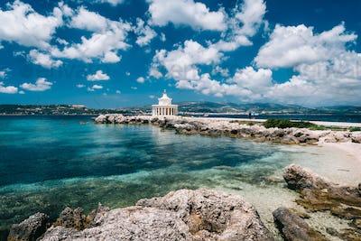 Amazing view of Saint Theodore Lantern. Picturesque landscape with beautiful clouds. Argostoli