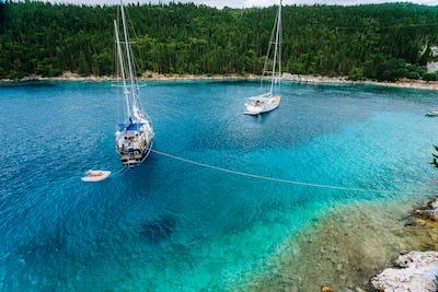 Crystal clear transparent blue turquoise teal mediterranean sea water of Foki Fiskardo Beach with