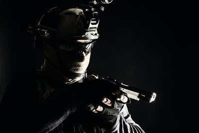 Police SWAT team fighter aiming service pistol