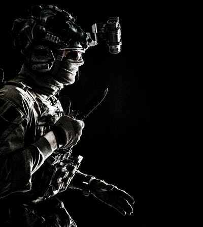 Elite commando soldier sneaking with knife in hand