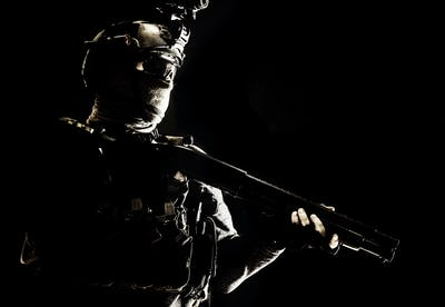Army elite troops soldier low key studio portrait