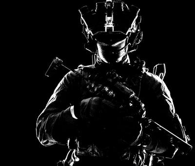 Modern army elite forces shooter in darkness