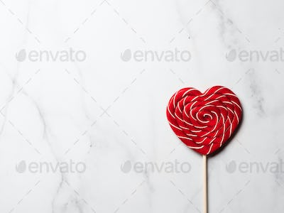 Sweet candy heart on white marble background