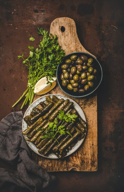Flat-lay of traditional turkish Dolma meze or snack on board