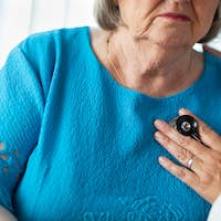 Female Doctor Checking The Heart With Stethoscope of Senior Adult Woman