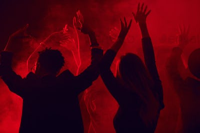 Crowd Dancing in Red Nightclub