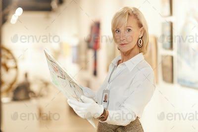 Mature Art Expert Examining Painting