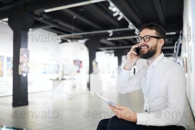 Bearded Businessman in Art Gallery