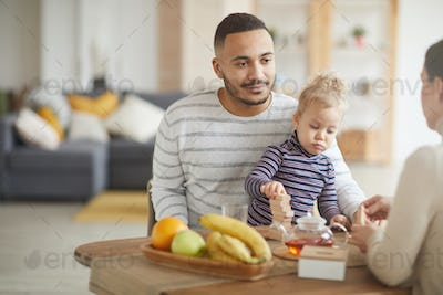Happy Young Father Enjoying Breakfast with Family