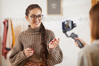 Smiling Young Woman Talking to Camera