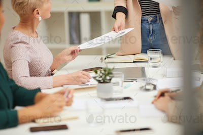 Unrecognizable Businesswoman Giving Hand-Outs