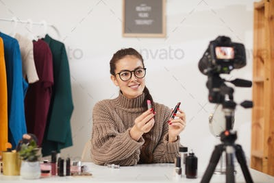 Young Woman Filming Beauty Tutorial Video