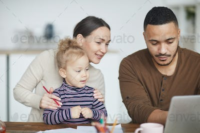 Mixed-Race Family Using Laptop at Home