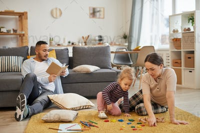 Family Playing with Little Girl at Home