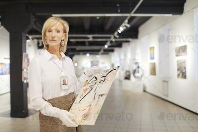 Female Art Expert Posing in Gallery