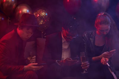People Using Smartphones in Nightclub