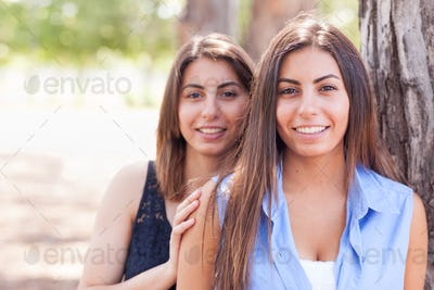 Two Beautiful Ethnic Twin Sisters Portrait Outdoors.