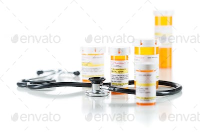 Group of Non-Proprietary Medicine Prescription Bottle with Stethoscope Isolated on White