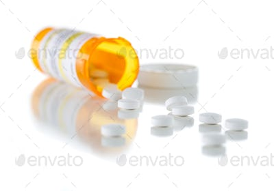Non-Proprietary Medicine Prescription Bottle and Spilled Pills Isolated on White