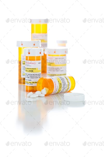 Non-Proprietary Medicine Prescription Bottles and Spilled Pills Isolated on White