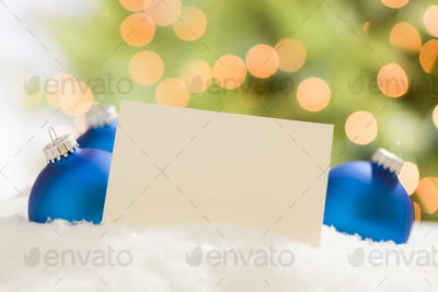 Blue Christmas Ornaments Behind Blank Off-white Card