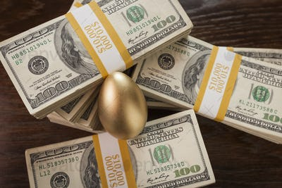 Golden Egg and Thousands of Dollars Surrounding