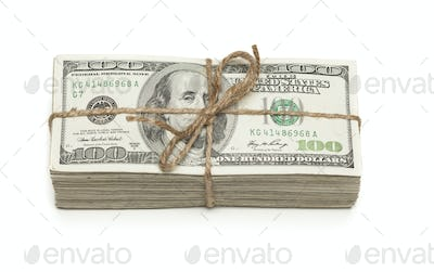 Stack of One Hundred Dollar Bills Tied in a Burlap String on White