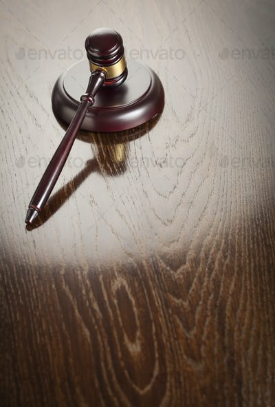 Wooden Gavel Abstract on Reflective Table