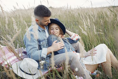 Very beautiful couple in a wheat field