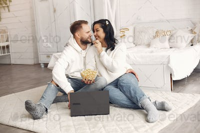 Beautiful couple spend time in a bedroom