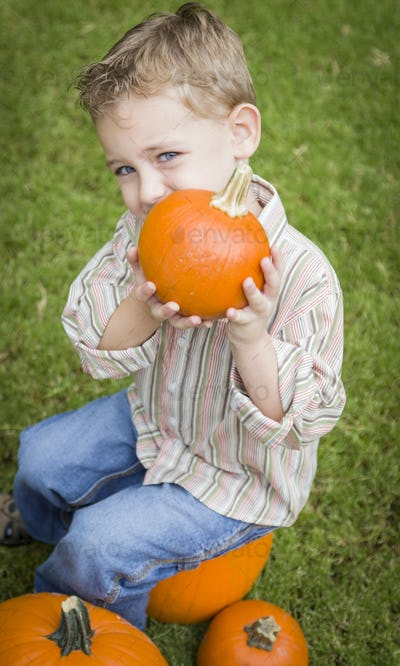 Cute Young Child Boy Enjoying the Pumpkin Patch.