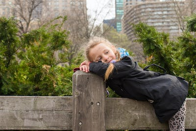 Adorable little girl have fun in Central Park at New York City
