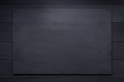 wooden nameplate at black background texture