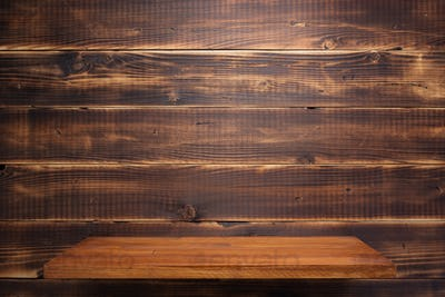 wooden plank shelf at wall