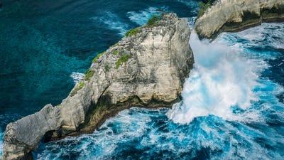 Beautiful Huge Wave hitting Rock on Atuh Beach, Nusa Penida, Bali, Indonesia
