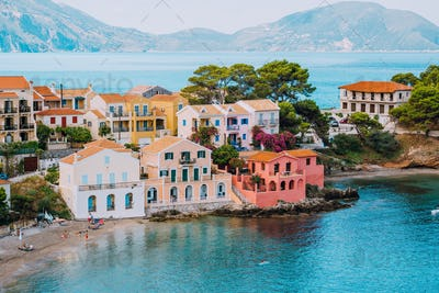 Assos village. Vivid colorful local house buildings close to transparent blue turquoise lagoon