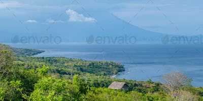 Beautifull evening view to St. Agung Vulcano on Bali from Nusa Penida Island. Partly Covered by
