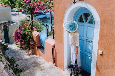 Blonde stylish woman on summer vacation on Kefalonia Island. Beautiful tanned woman enjoying the day