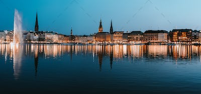 Beautiful panoramic view of Hamburg town hall - Rathaus and Alster river at spring earning evening