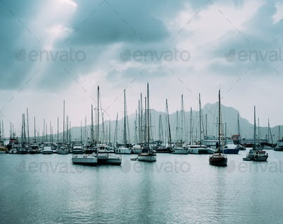 Sailboats and pleasure boats in the porto grande bay of the historic city Mindelo. Clodscape with