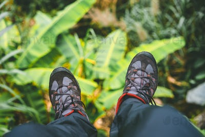 Hanging feet with trekking footwear after long hike from the mountains on Santo Antao Island, Cape