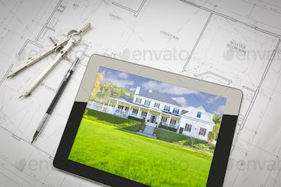 Computer Tablet Showing House Image On House Plans, Pencil, Compass